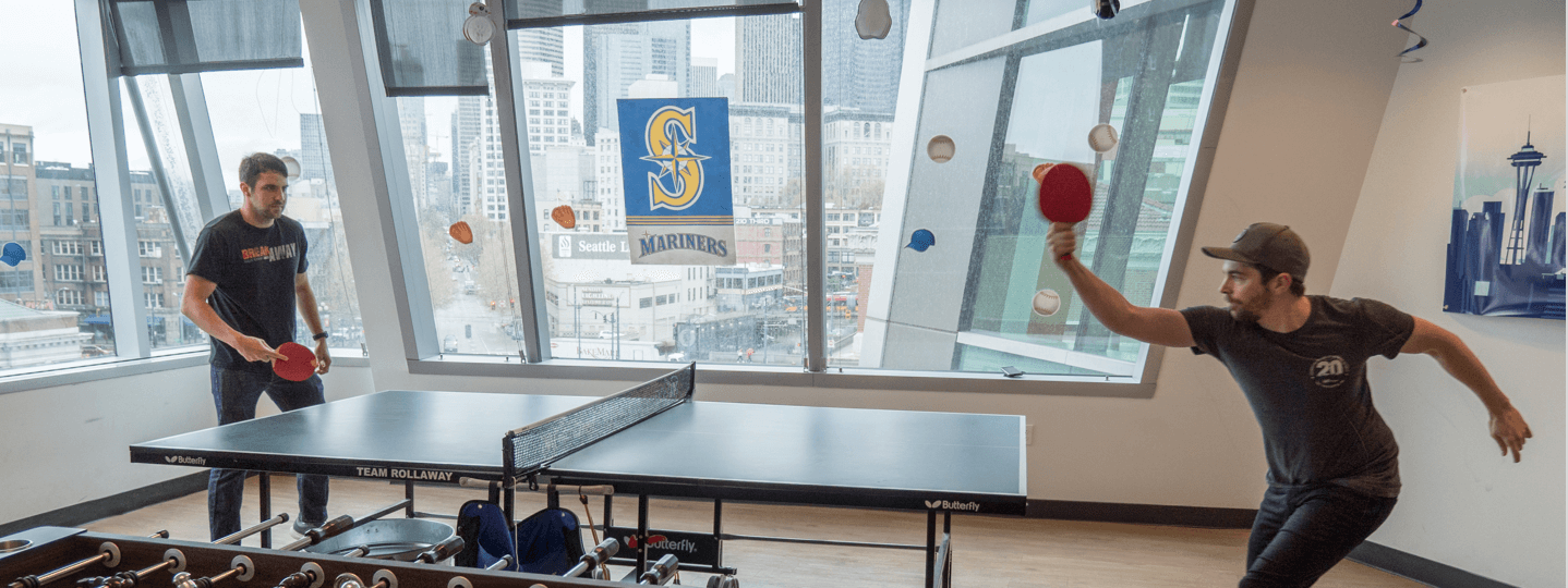 WatchGuard Employees playing ping pong in the lunch room