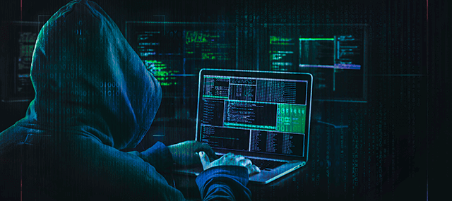 Sketchy-looking hacker in a hoody looking at a dark web screen