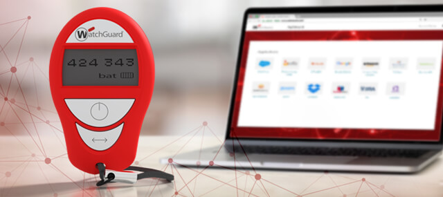 Red WatchGuard hardware token in front of a laptop showing WatchGuard AuthPoint