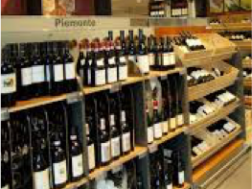 Red wine arranged on store shelves