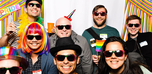 WatchGuard employees at a company holiday party photo booth