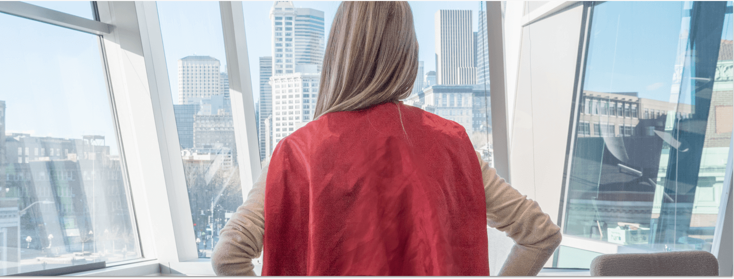 WatchGuard Employee facing away from camera with a red cape on